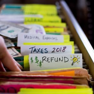 """colorful files with tab showing """"taxes"""" and """"refund"""""""