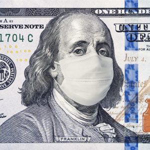 close up of a one hundred dollar bill with Ben Franklin wearing a mask